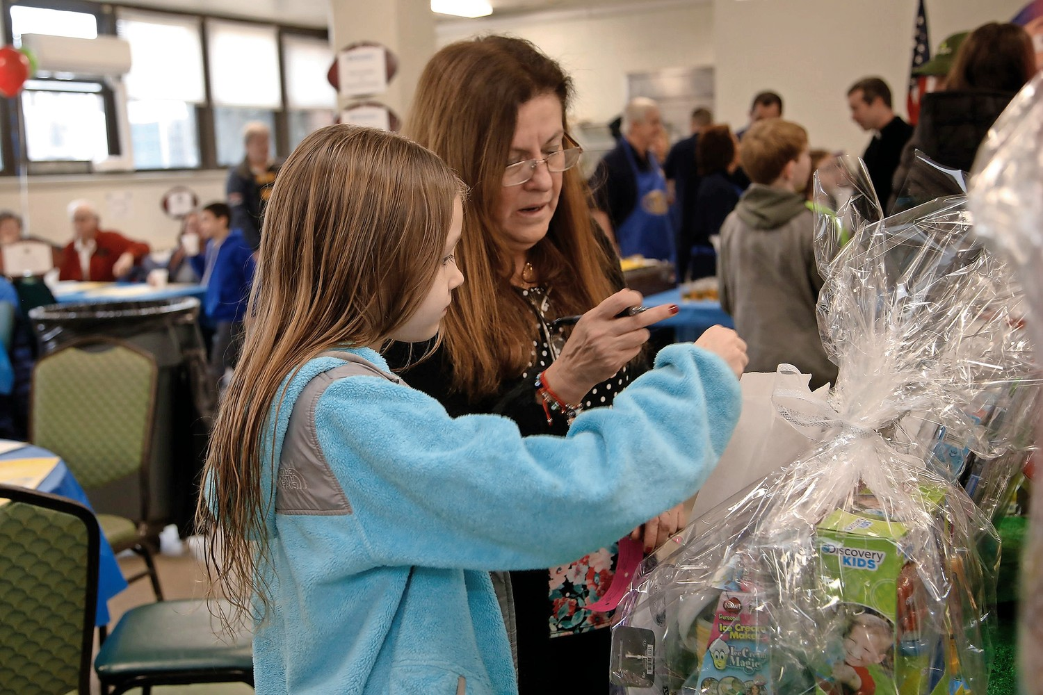 Hailey Naughton, age 9, with her grandmother, Arlette Naughton, choose their raffles.