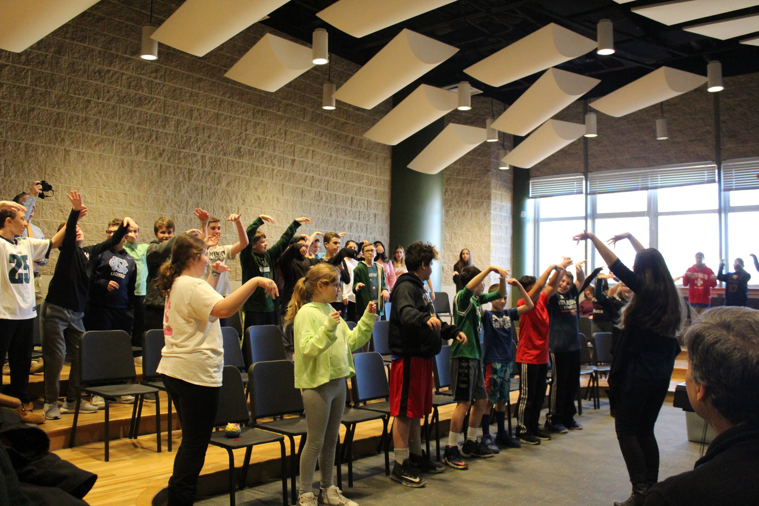 "As part of ""Wonder Day"" at Lynbrook North Middle School, students danced to see how someone with disabilities might not be able to perform similar movements."