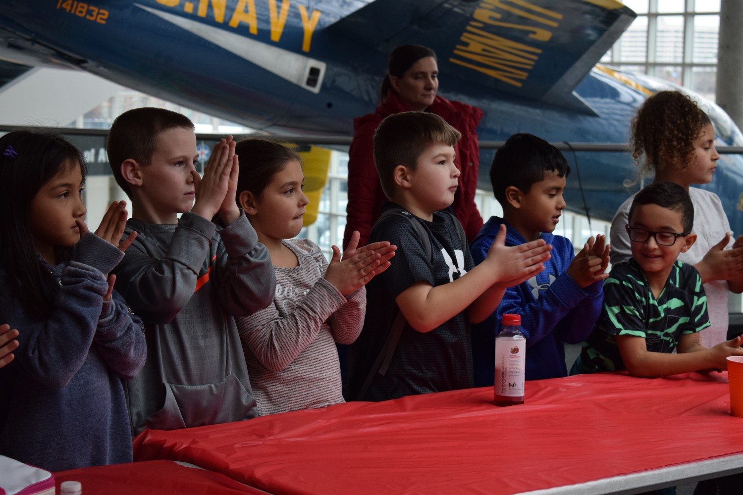 Third-graders from Polk Street Elementary School in Franklin Square rubbed their hands together to simulate the friction that occurs when Mars rovers land on the red planet.