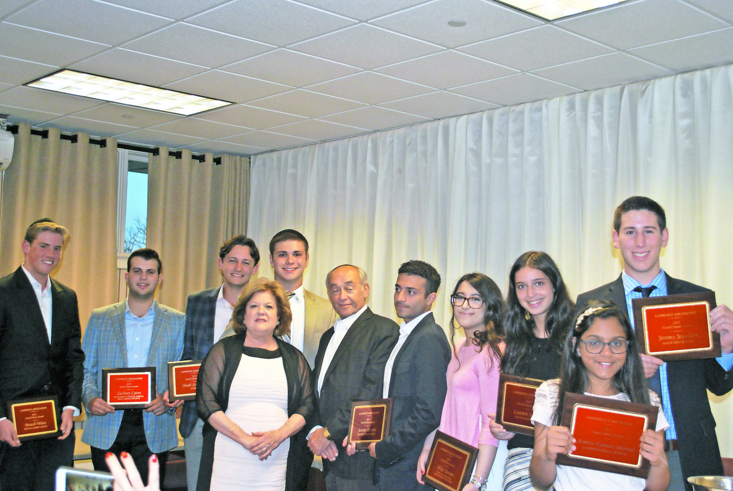 The Lawrence Association, recognized Five Towns students last June with citizenship awards. From left were Pesach Weiss, Zachary Lyons, Noah Schwartz, Past President Sharon Douglas, Donny Moskovits, Lawrence Mayor Alex Edelman, Jeremy Tanami, Aliya Tanami, Lauren Safran, Asmita Kumari Jaiswal and Jeremy Jesselson.