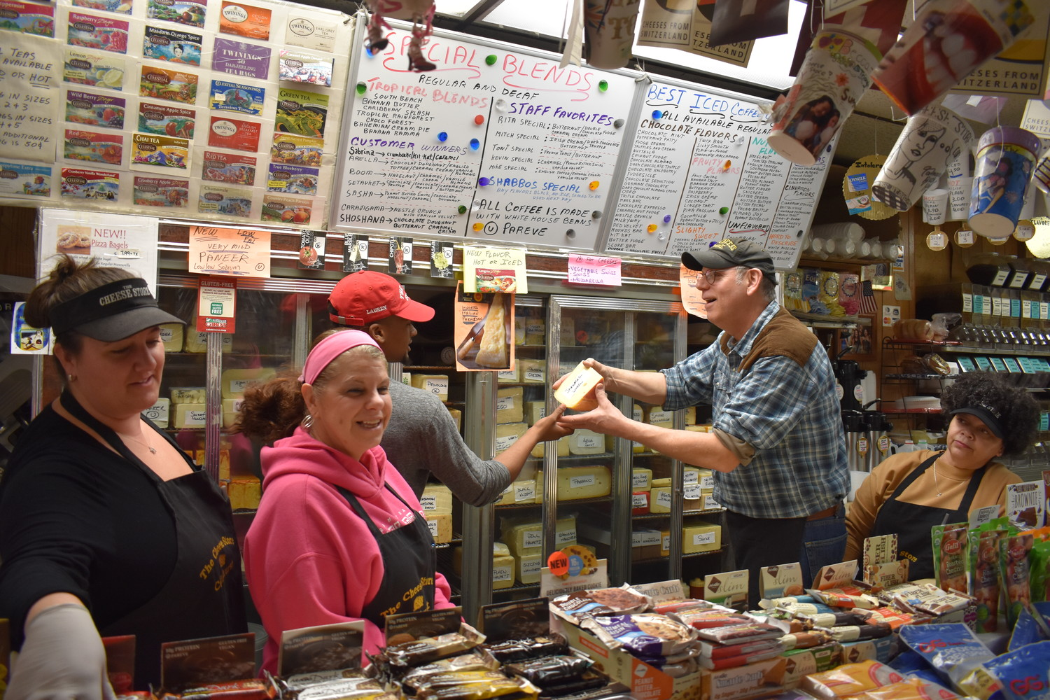 Cheese Store owner Mitch Rakita has run the business for 41 years, and also behind the counter is a combined 86 years of experience. From left, Angela Volante, Rita Volante, Malik Highsmith, Rakita and Antoinette Ortiz.