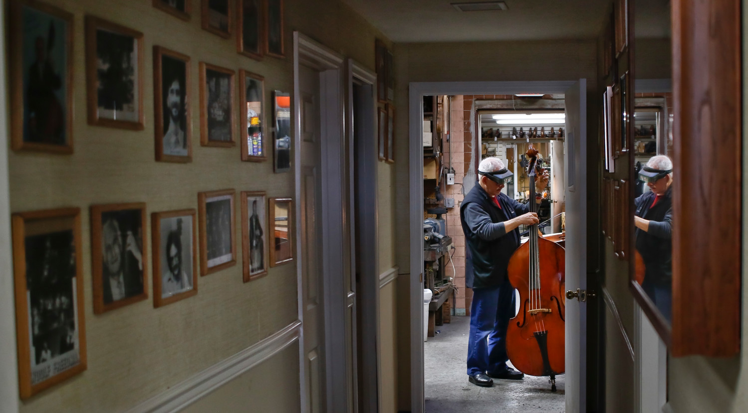 Jake Cradilas, a shop foreman who has worked at Kolstein's for nearly 25 years, gave a newly repaired bass its final evaluation.