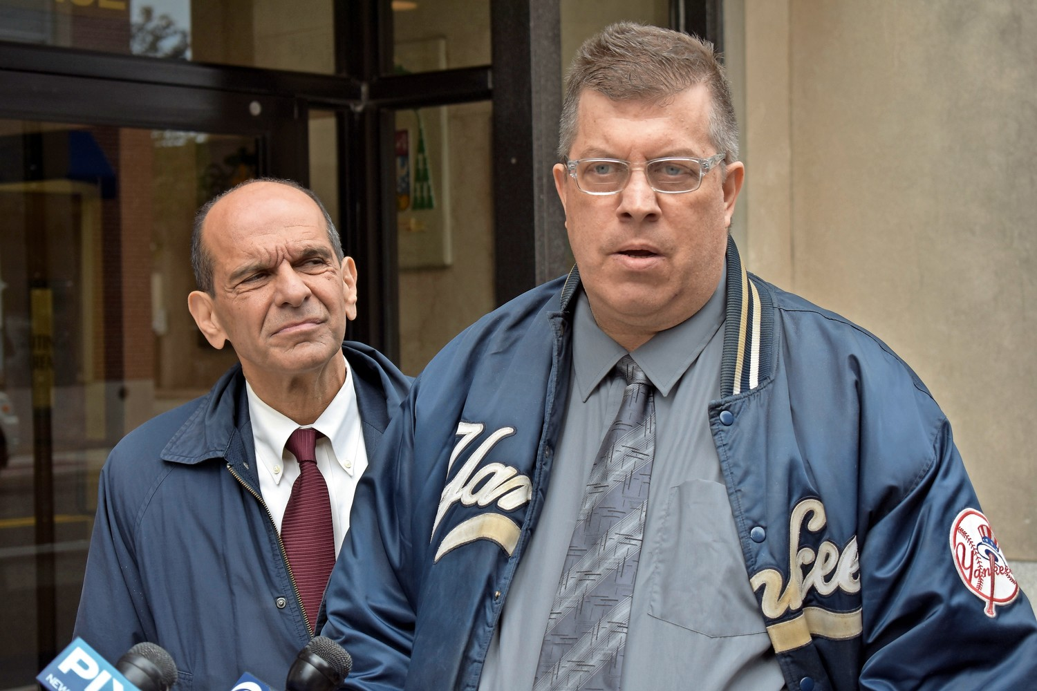 Thomas McGarvey, right, outside the Diocese of Rockville Centre's headquarters last October, received $500,000 through the Independent Reconciliation and Compensation Program. Boston attorney Mitchell Garabedian, left, represented him.