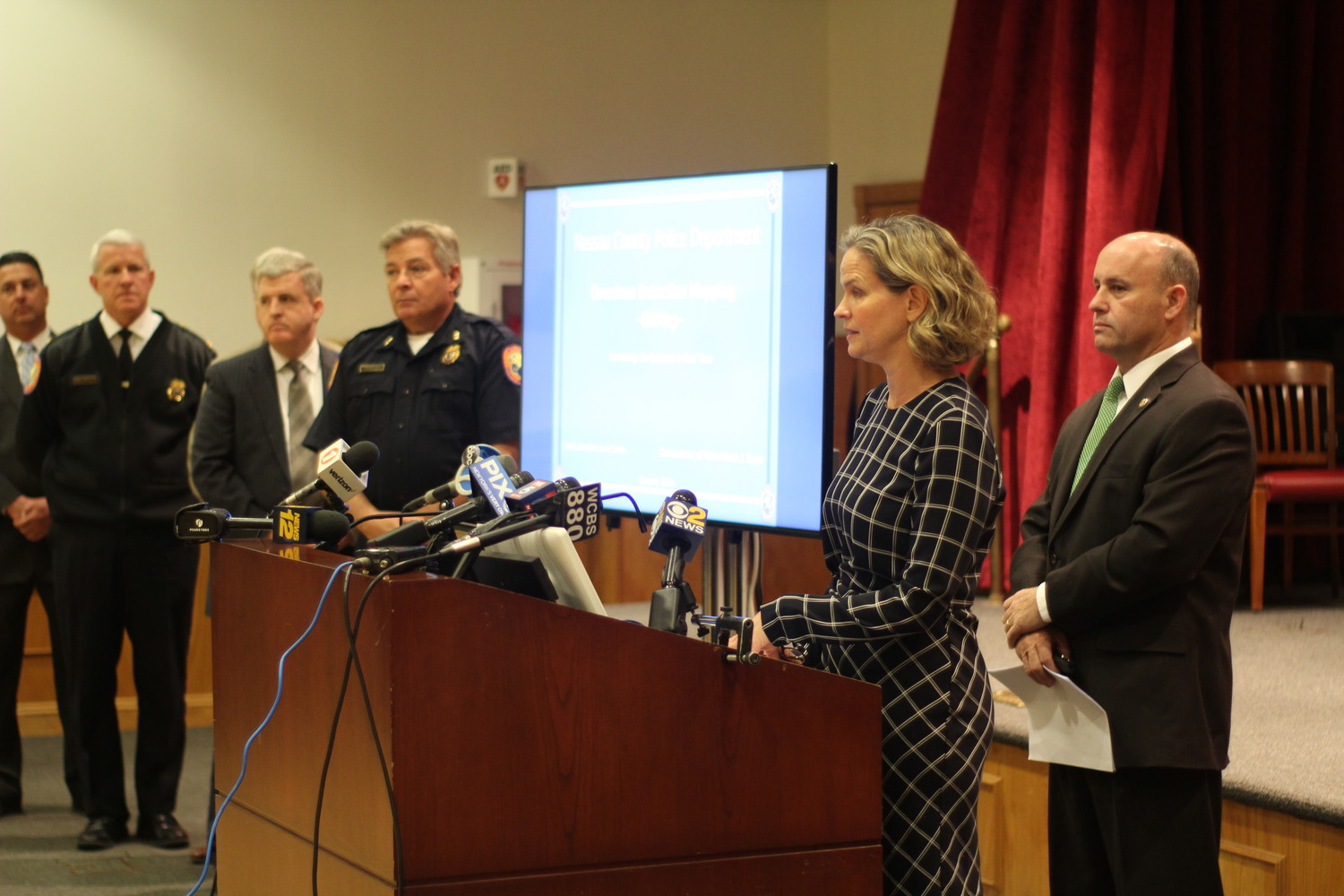 Nassau County Executive Laura Curran spoke about how real-time data that will help the police department tackle the county's overdose problem, while Nassau County Police chiefs and other local elected leaders stood in attendance.