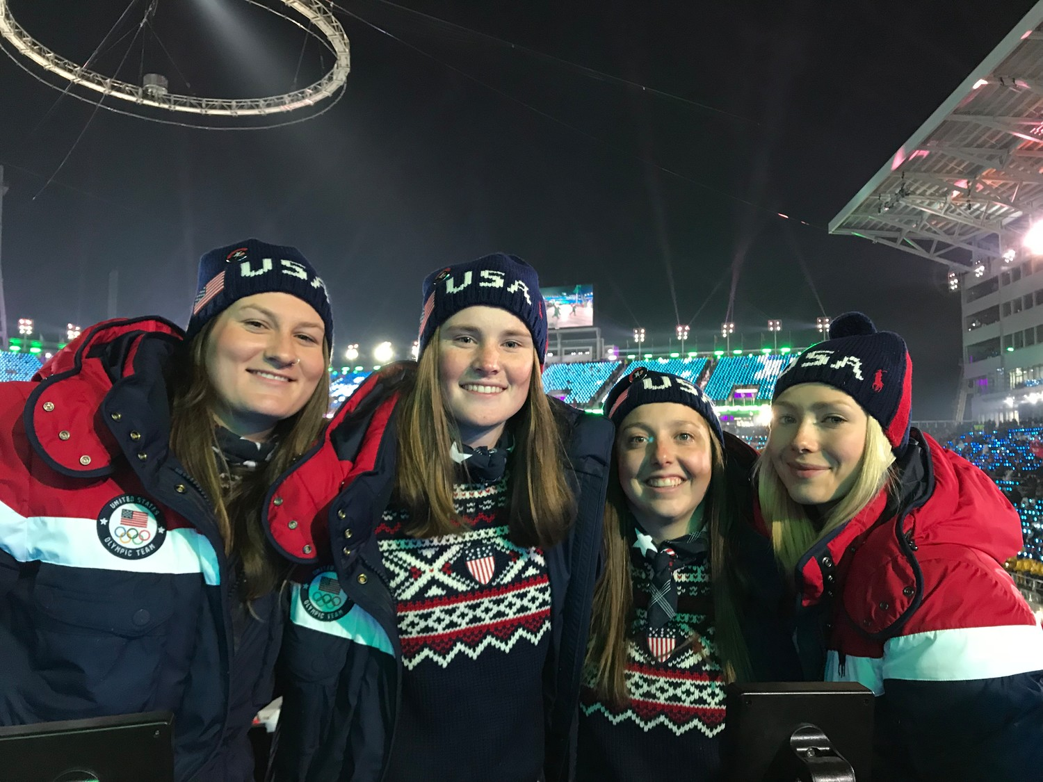 Devin Logan, left, with Caroline Clair, Darian Stevens and Maggie Voisin of the 2018 U.S. Women's slopestyle team at the Winter Olympics opening ceremony last week.  Logan won the inaugural silver medal in the sport  at the 2014 Olympics in Sochi, Russia.
