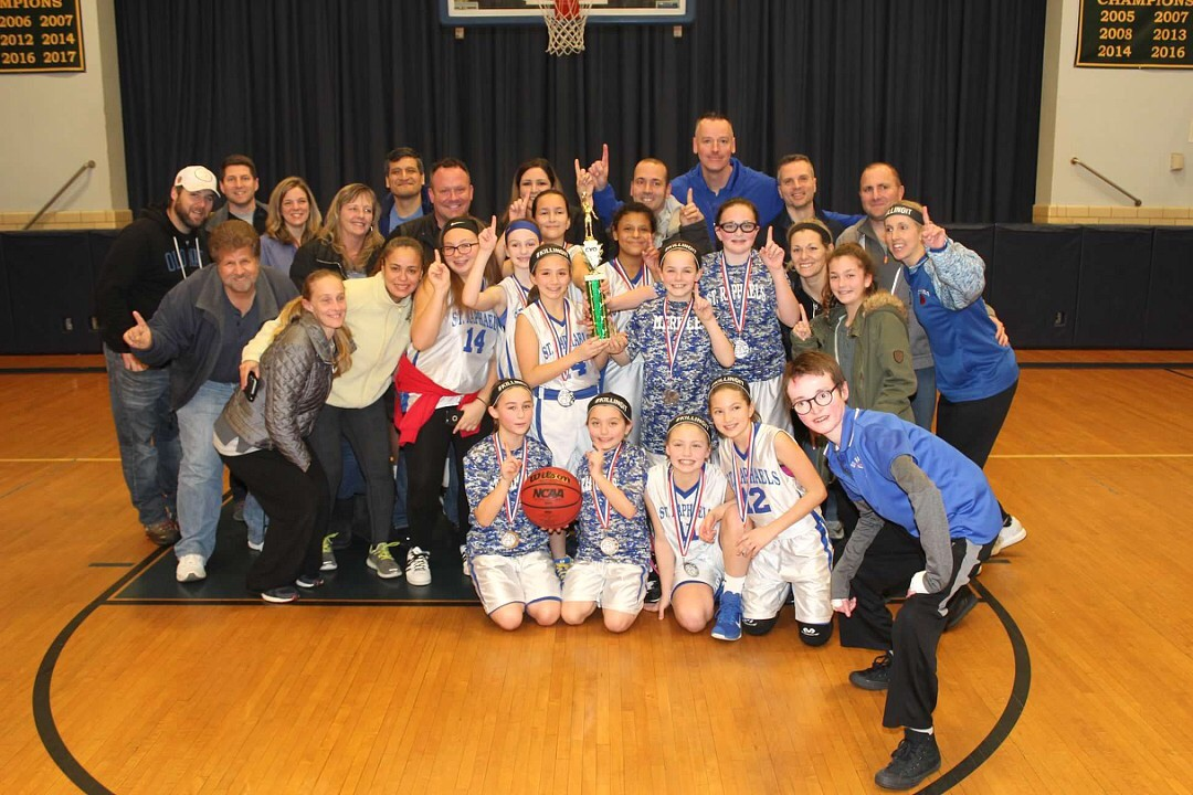 The St. Raphael's Catholic Youth Organization's fifth-grade girls' basketball team made history on Feb. 11 when they took home the CYO's first A Division championship.