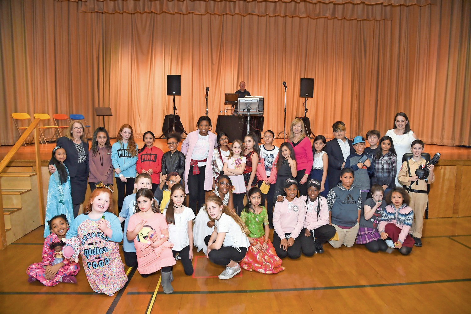 Lawrence Elementary School students sang, danced and played a musical instrument at its first-ever talent show. At the far left is Lawrence Superintendent Dr. Ann Pedersen, in the center is LES Principal Rina Beach and at the far right is Assistant Principal Jackie Beckman.