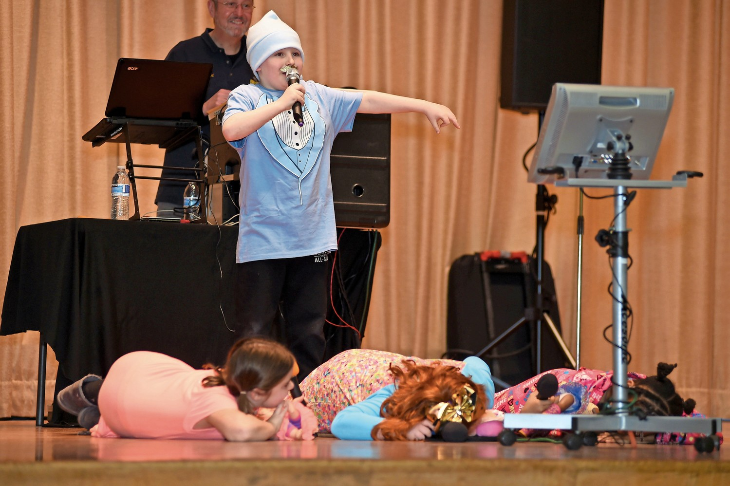 "The first-ever Lawrence Elementary School talent show on Feb. 2 included 32 students singing and dancing. Ian Fishman, standing, and from left Haley Katz, Erin Fishman and Lauryn Singletary performed ""Mr. Sandman."""