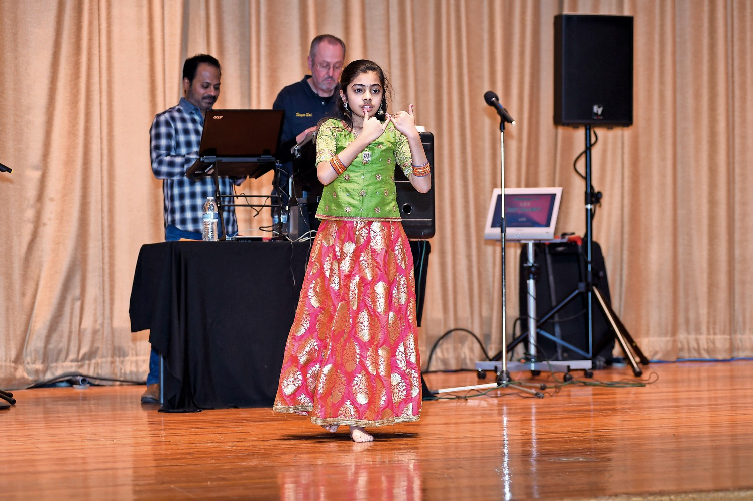 "Sunaina Samala danced to ""Radha"" a dance created by Ruth St. Denis in the early 20th century based on the milkmaid Radha, a companion of the Hindu god Krishna."