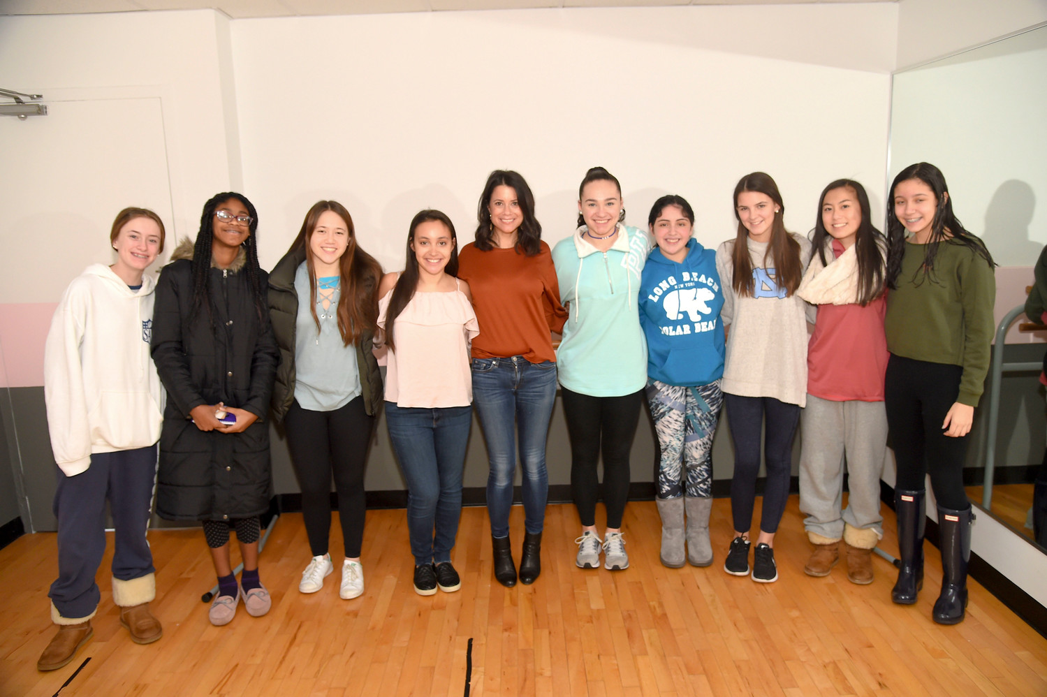 Cameron Churchfield, left, Hana Damas-Sylvain, Sadie Brett-Chin, Sydney Brett, founder of Sydney's Smiles, guest speaker Sandy Bassin, Bailey Mullen, Shannon Smith, Lindsay Miller, Megan Tierney and Juliana Smith joined together for a Girls Empowerment Workshop in Rockville Centre on Feb. 4.