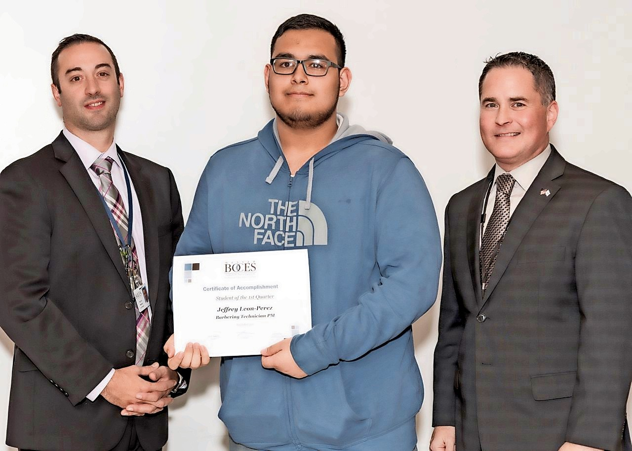 Jeffrey Leon-Perez, center, of Hewlett, was congratulated on being named Student of the Quarter by Nassau BOCES Barry Tech Assistant Principal Patrick Dunphy, far left, and Principal Peter Dalton.
