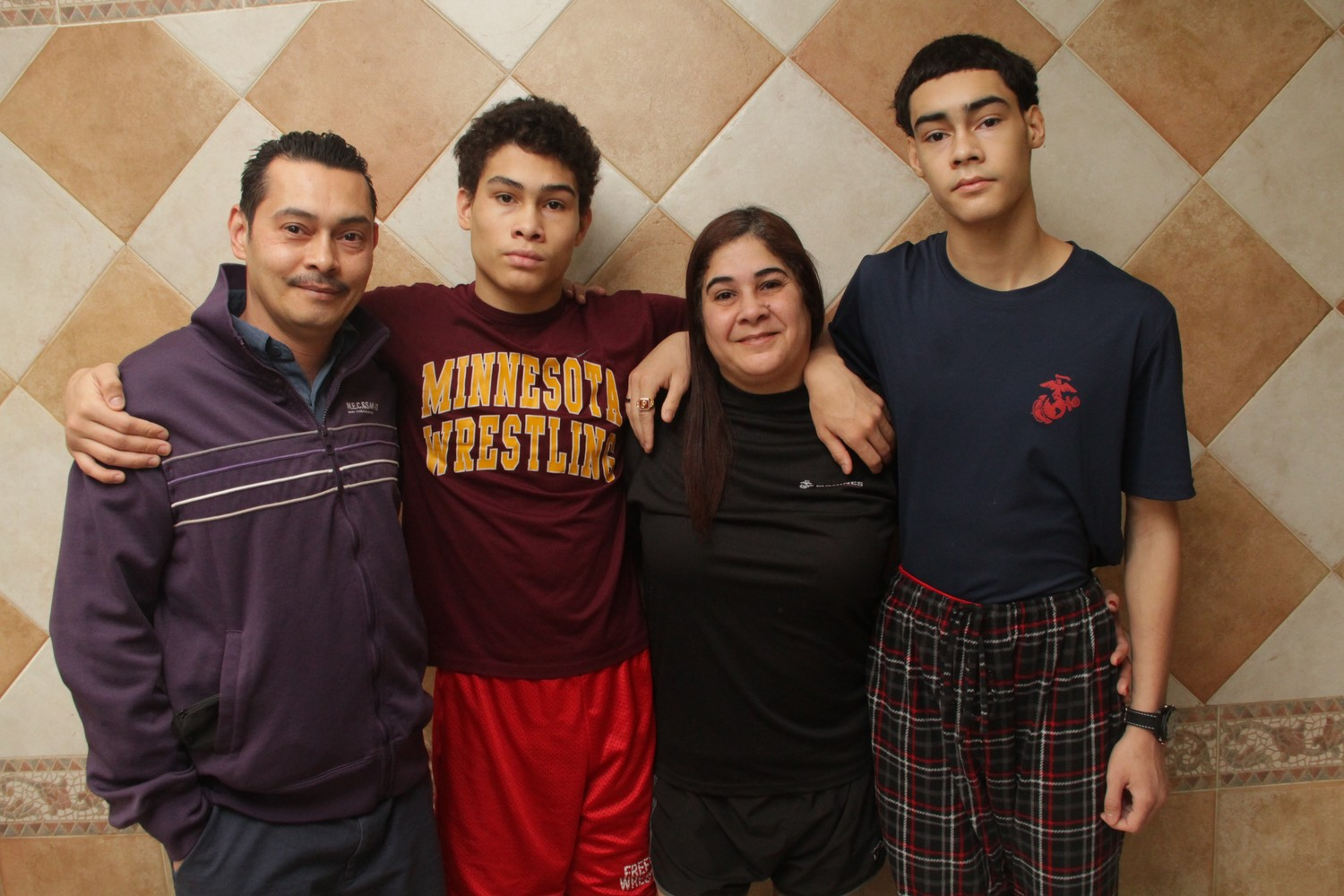 The Mauras family, including Sergio, left, Lee, Elizabeth and Sebastian, right, were all smiles after having a family discussion about Sebastian's decision to join the United States Marine Corps.