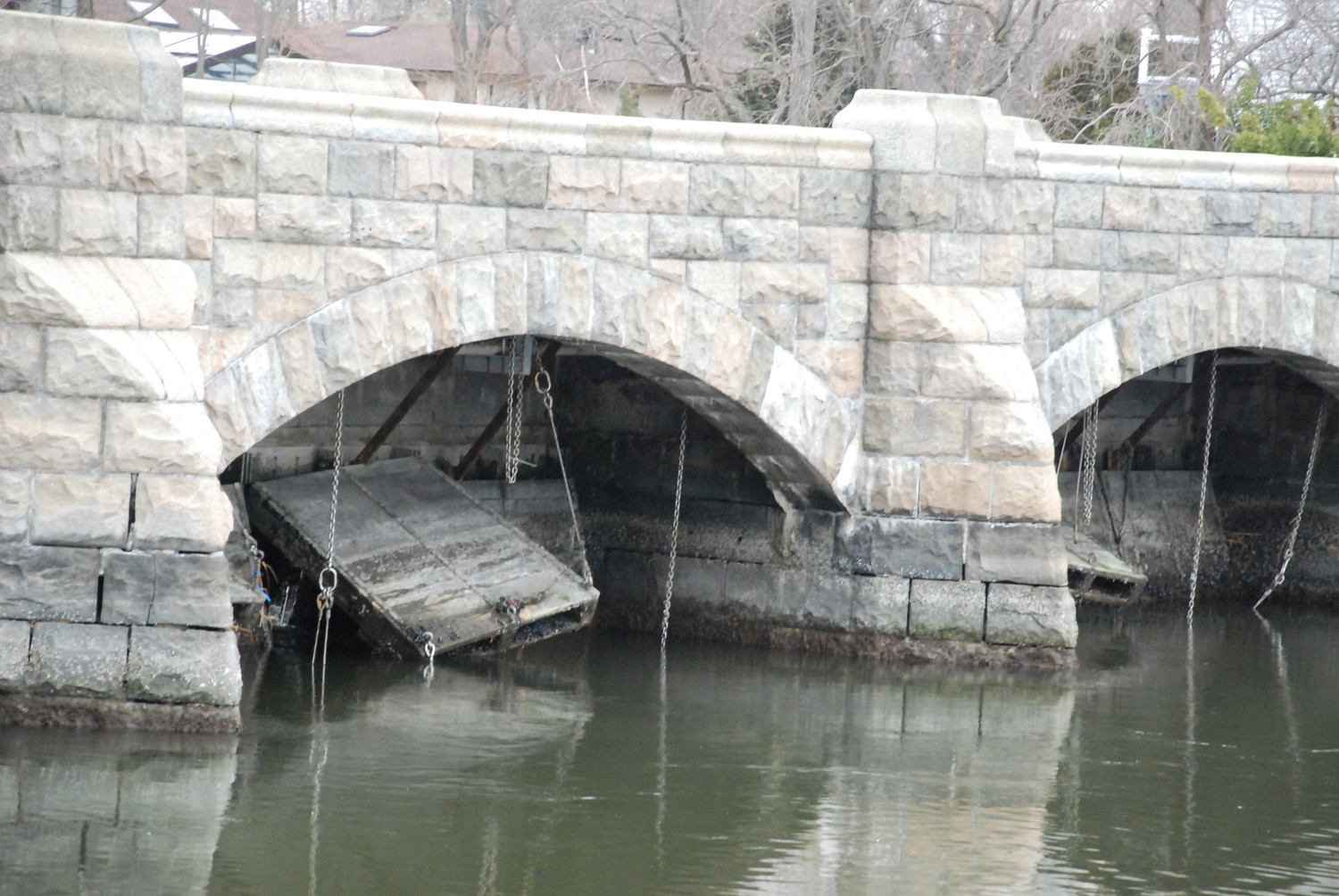 One of the broken tidal gates under the East Island Bridge over Dosoris Pond, which for decades has been failing to properly regulate flow between the pond and the Long Island Sound.