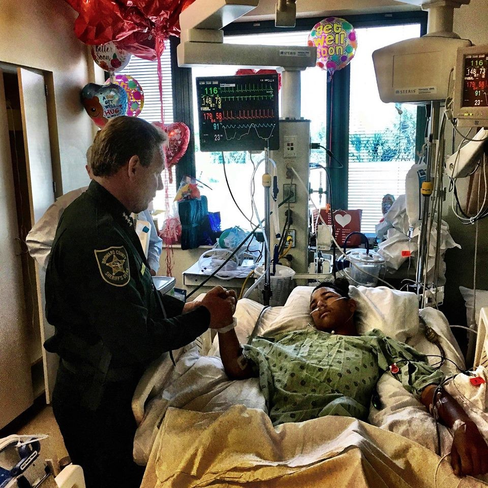 Israel posted this photo on Facebook of his visit with one of the school shooting victims, Anthony Borges, 15, in the hospital on Sunday. Borges's family said he was shot five times.