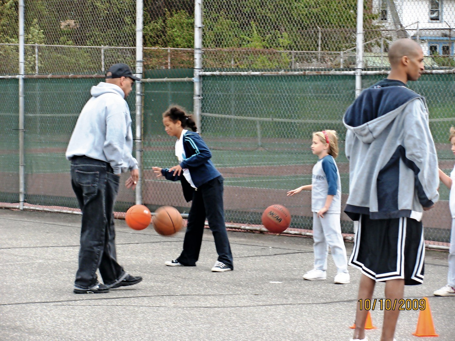 Alexis Lake, at left, practiced with her father, Chris, when she began her basketball journey.