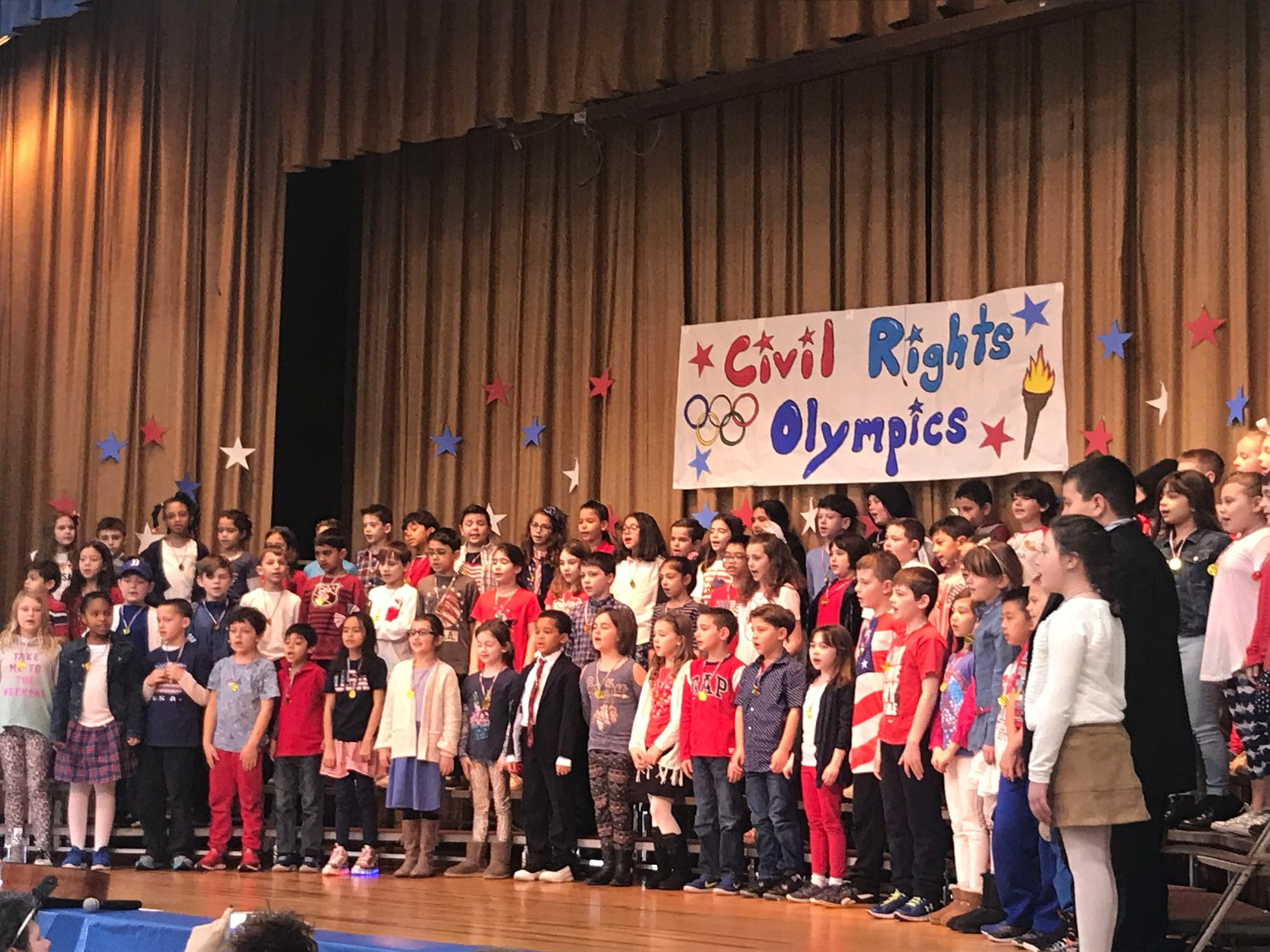 Marion Street School third-graders performed songs and skits in the Civil Rights Olympics, and presented visitor Joseph McNeil with a gold medal at the end of their performance. McNeil was part of the Greensboro, N.C. sit-ins at Woolworth's, in protest of segregation in 1960