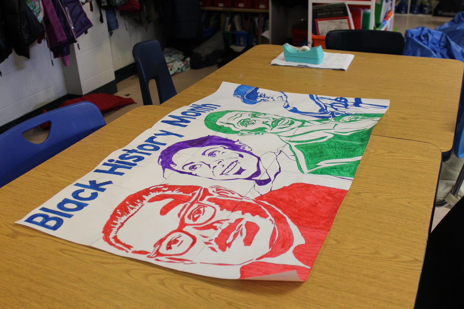 The fourth-grade students each colored a square to create a poster of influential African American figures throughout history.