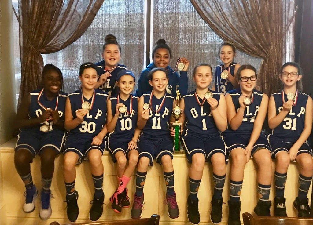 The Our Lady of Peace Catholic Youth Organization fifth-grade girls' basketball team won the Division C championship on Feb. 11.