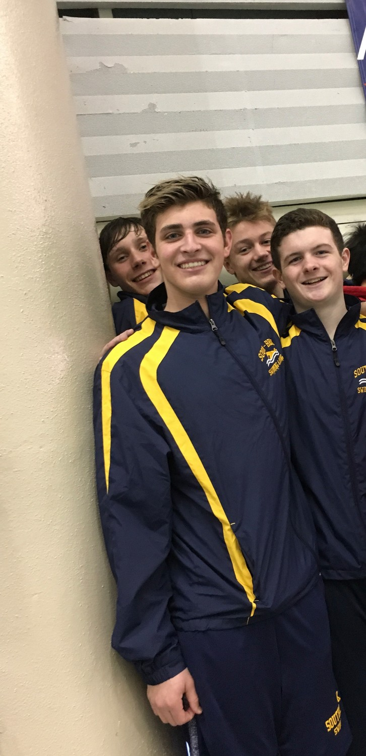 Timothy Marski, left, Daniel Dalrymple, Ryan Davidoff and Kyle Bergin set a county record at the Nassau boys' swimming championships on Feb. 10 with a 200-yard medley relay time of 1:35.72.