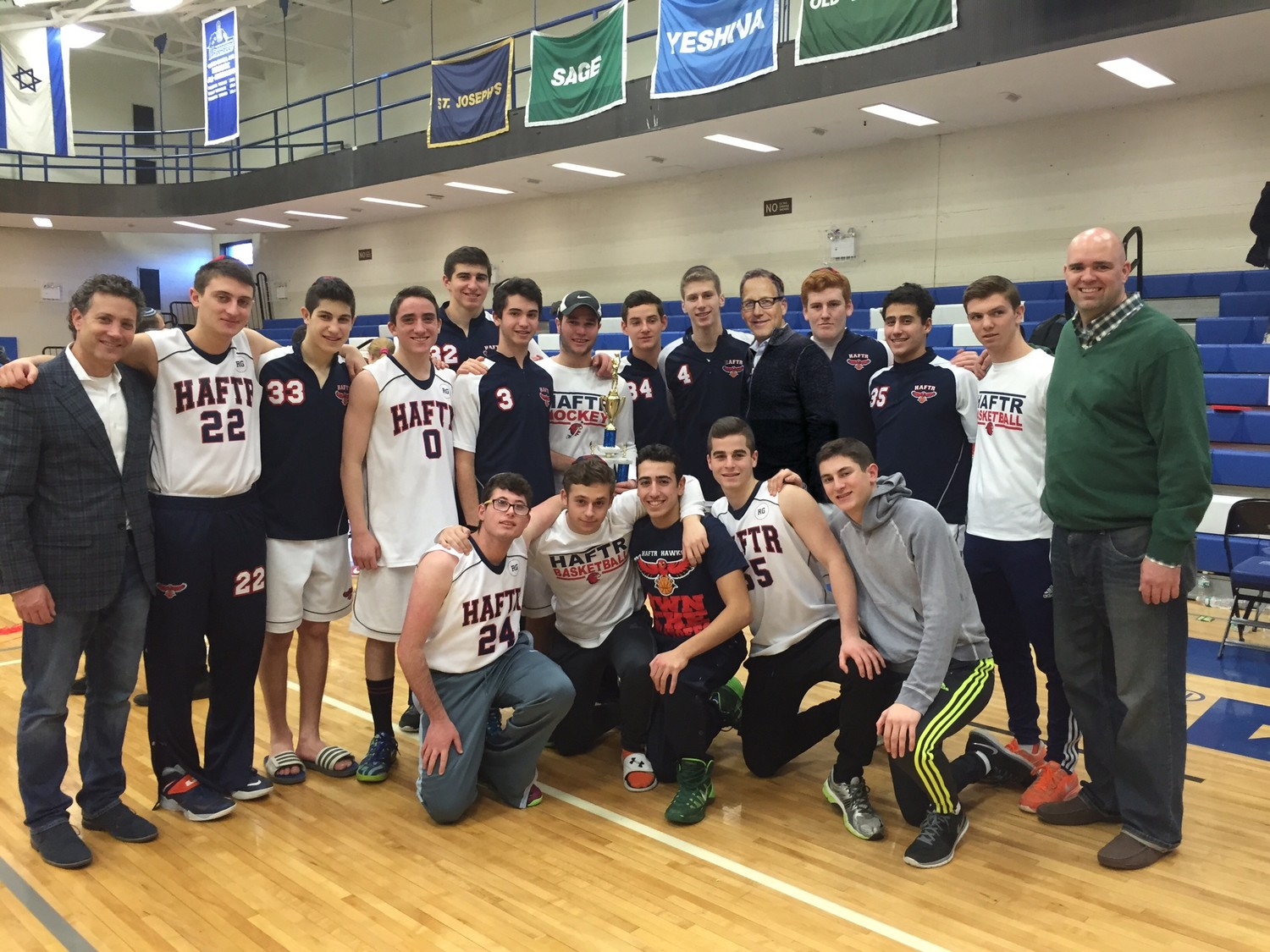 HAFTR's sports program has also been successful. The undefeated boys basketball team captured the Metropolitan Yeshiva League title in 2016. Athletic Director Joey Hoenig is on the far left. On the far right is coach Scott Ferguson.