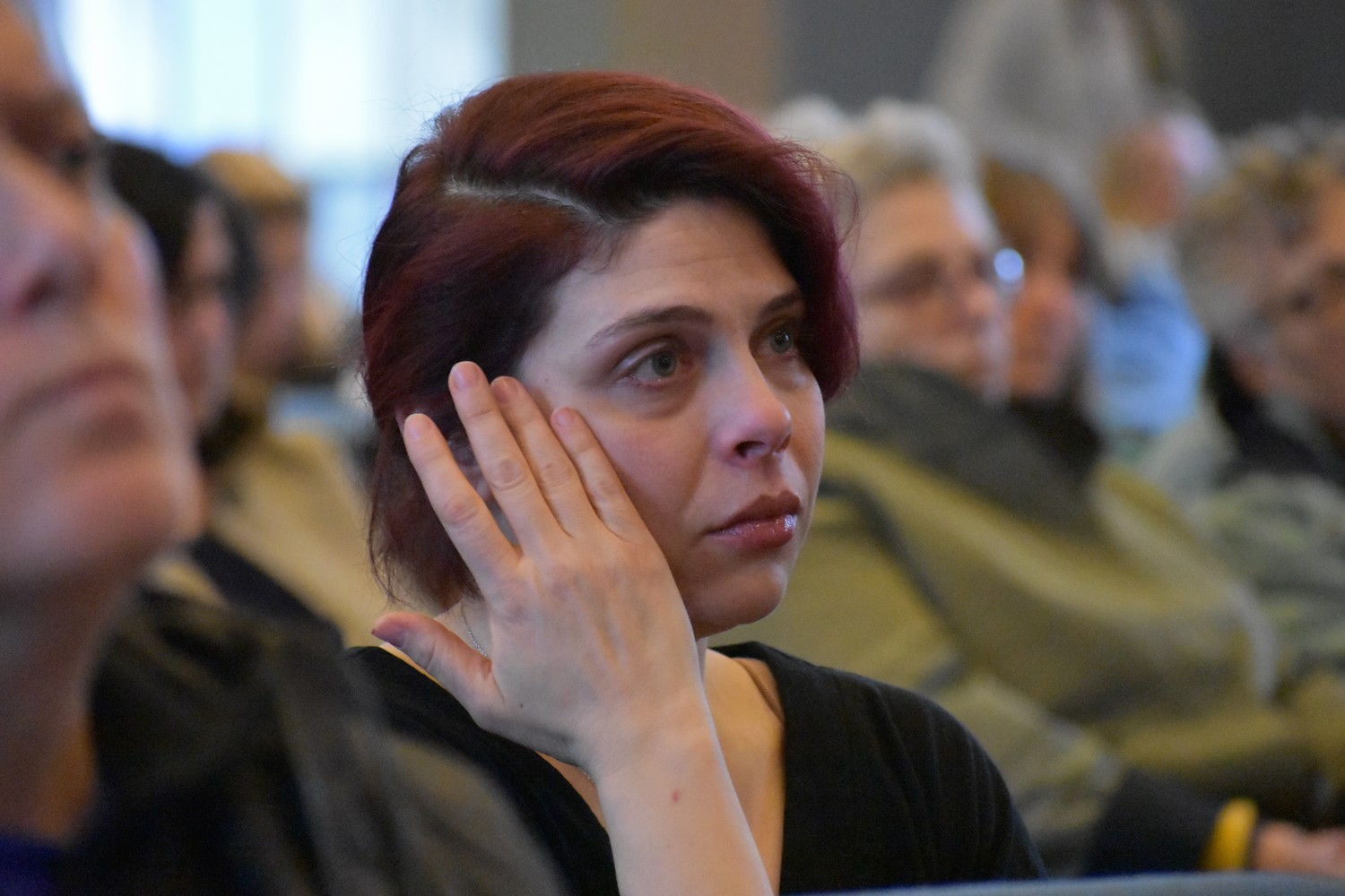 Rockville Centre resident Arielle Kane wiped away tears during a vigil on Feb. 16 at Central Synagogue-Beth Emeth, which remembered the victims of the school shooting in Parkland, Fla.
