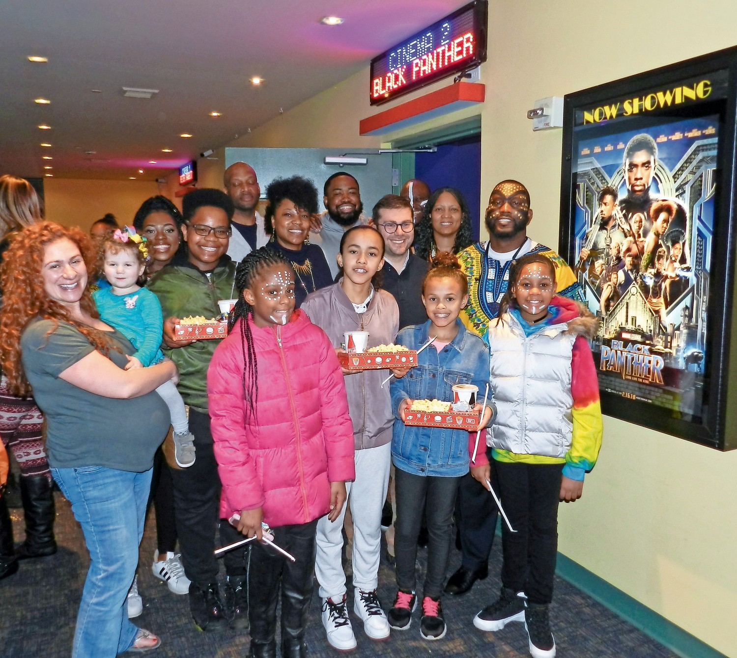 "More than 100 kids from the MLK Center, joined by family members, organizers and supporters, turned out for ""Black Panther"" at the Long Beach theater on Tuesday thanks to the center's Black Panther Challenge to fund a free screening for kids."