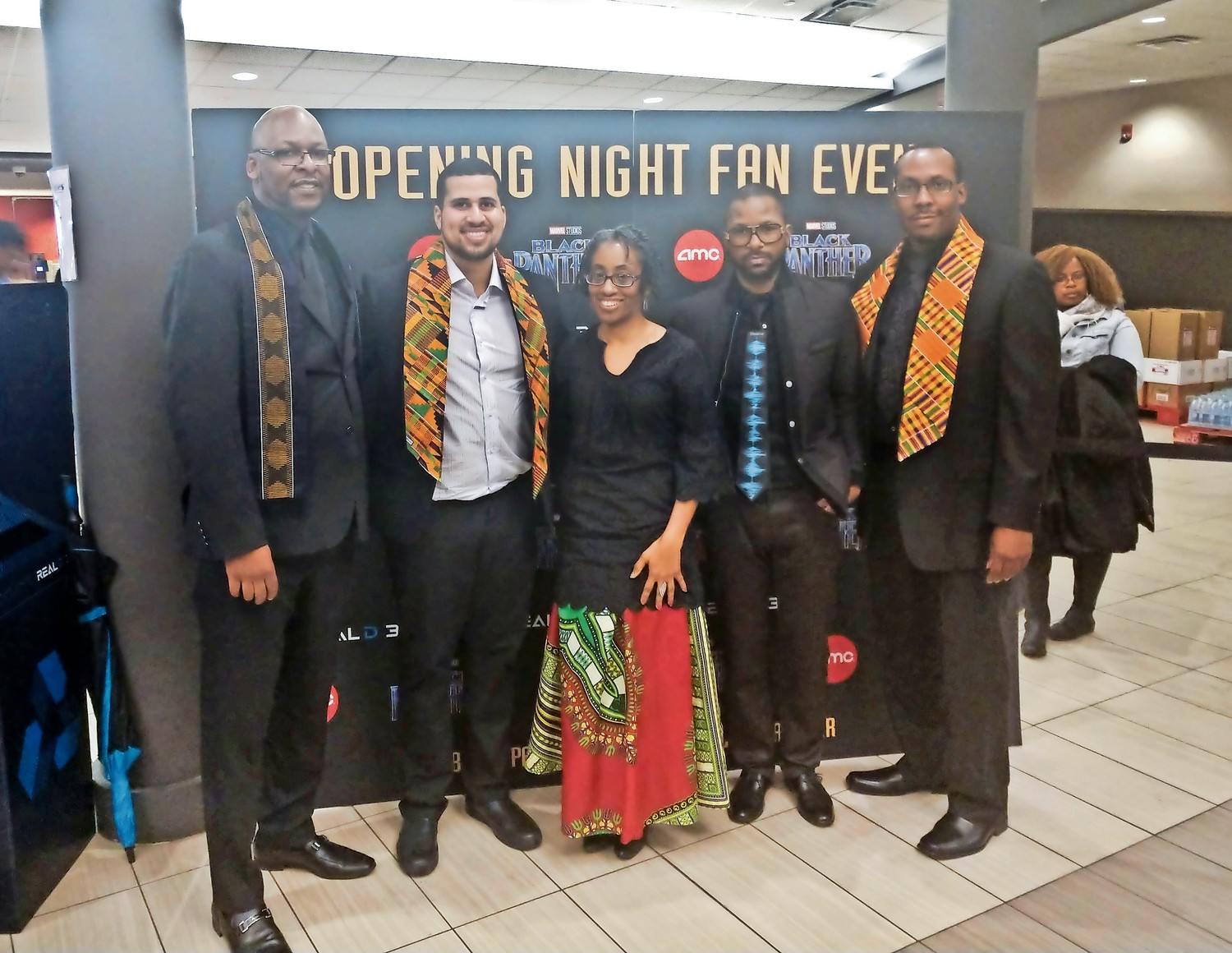 "Marcus Tinker, far left, Ronald McHenry, City Councilwoman Anissa Moore, LeRon West and Runnie Myles at the opening of ""Black Panther"" at AMC Roosevelt Field on Feb. 15."