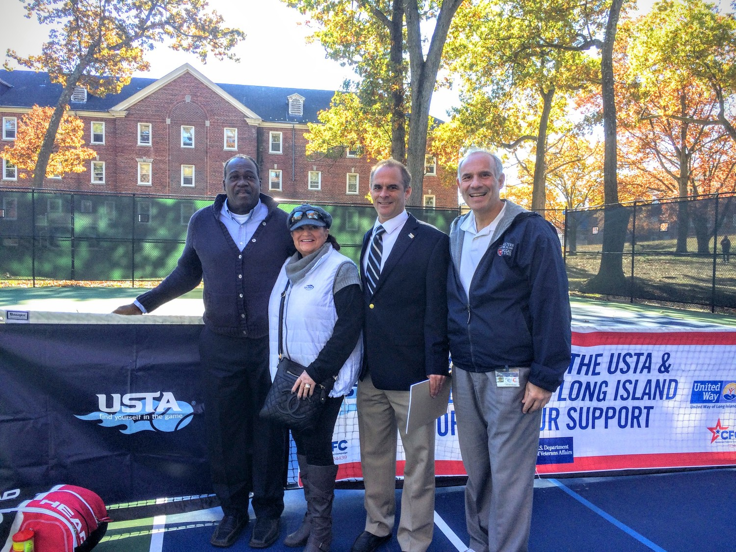 Daniel Burgess was joined by USTA Long Island Region board members Sunny Fishkind, Craig Fligstein and Mike Pavlides at the dedication of the renovated tennis courts at the Northport VA Medical Center.
