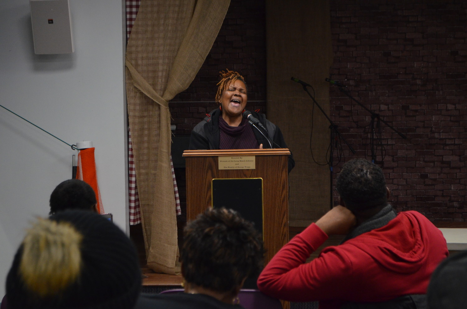 "Kathy Campbell, of Harvest on the Atlantic, sang original lyrics at an open mic program called ""Still We Rise"" at the library on Feb. 13 to honor Black History Month."