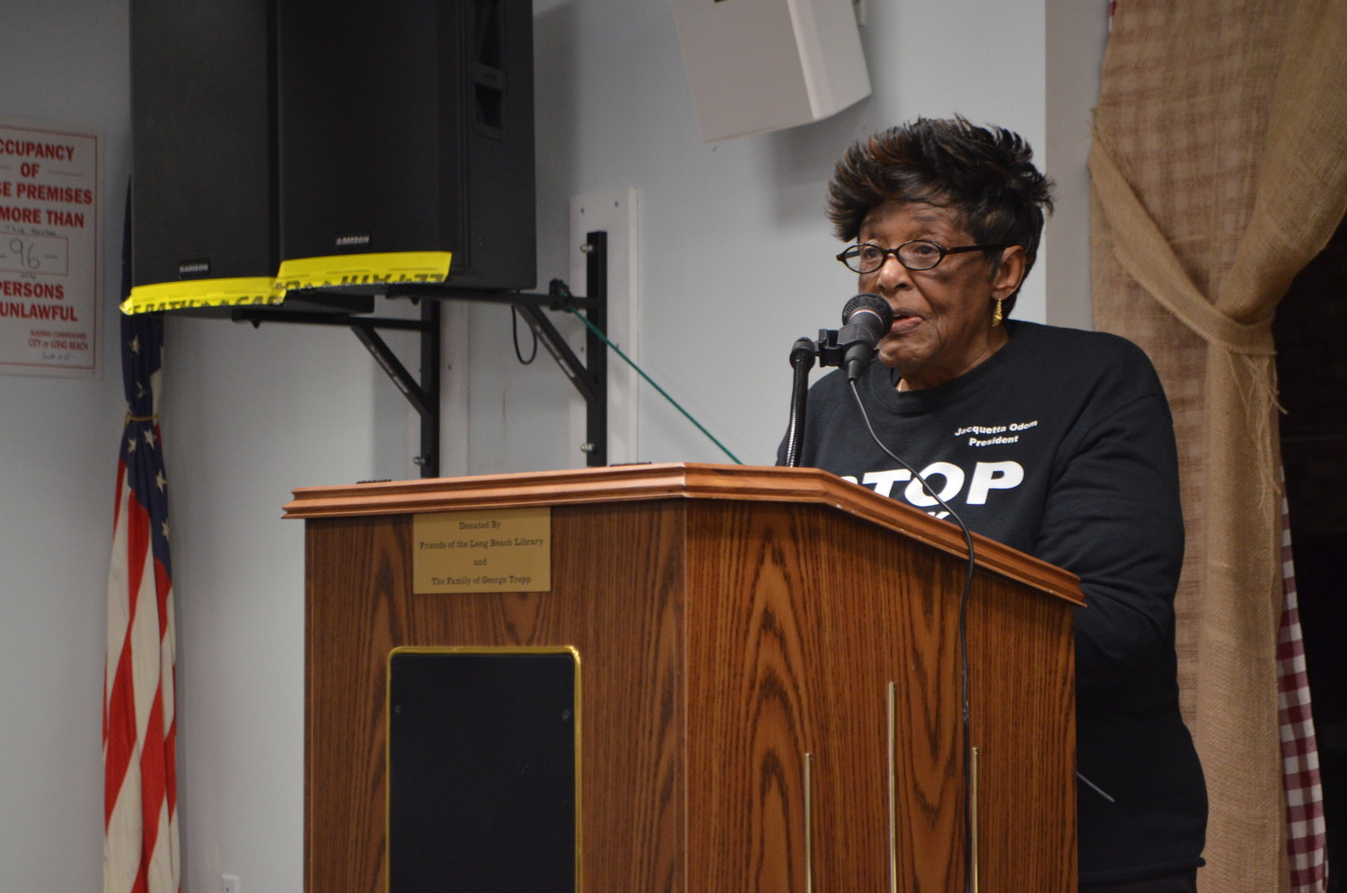 Jacquetta Odom, president of the Concerned Citizens of North Park, recited a poem by John Hall.