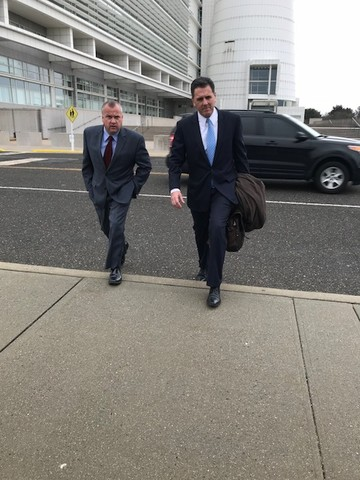 Former Assemblyman and deputy county executive Rob Walker, left, was arraigned in U.S. District Court in Central Islip on Thursday. His attorney, Brian Griffin, right, told reporters outside the courthouse that Walker had done nothing wrong.