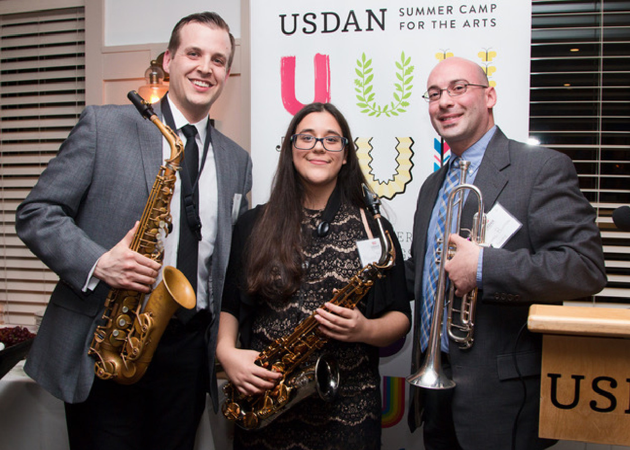 Accomplished Glen Cove High School saxophonist Michele D'Ambrosio with Usdan Summer Camp for the Arts junior bands director Mark Bligh, left, and lead trumpet teacher Mike Blutman.