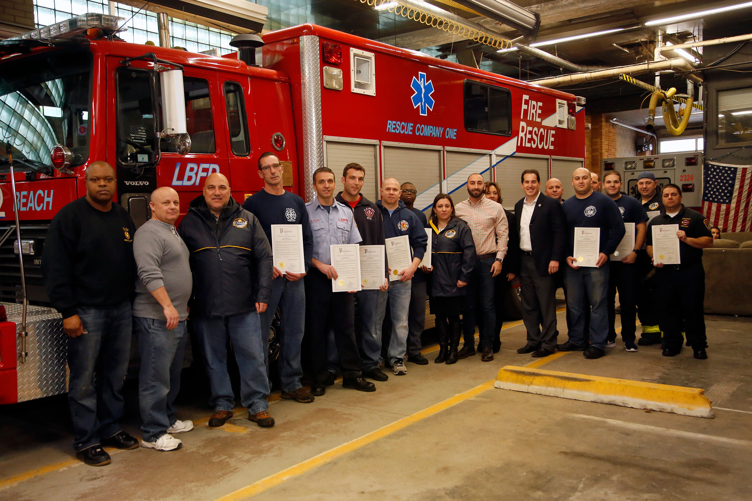 State Sen. Todd Kaminsky, seventh from right, honored members of the Long Beach Fire Department on Sunday for saving a trapped driver from his overturned vehicle on Feb. 15.