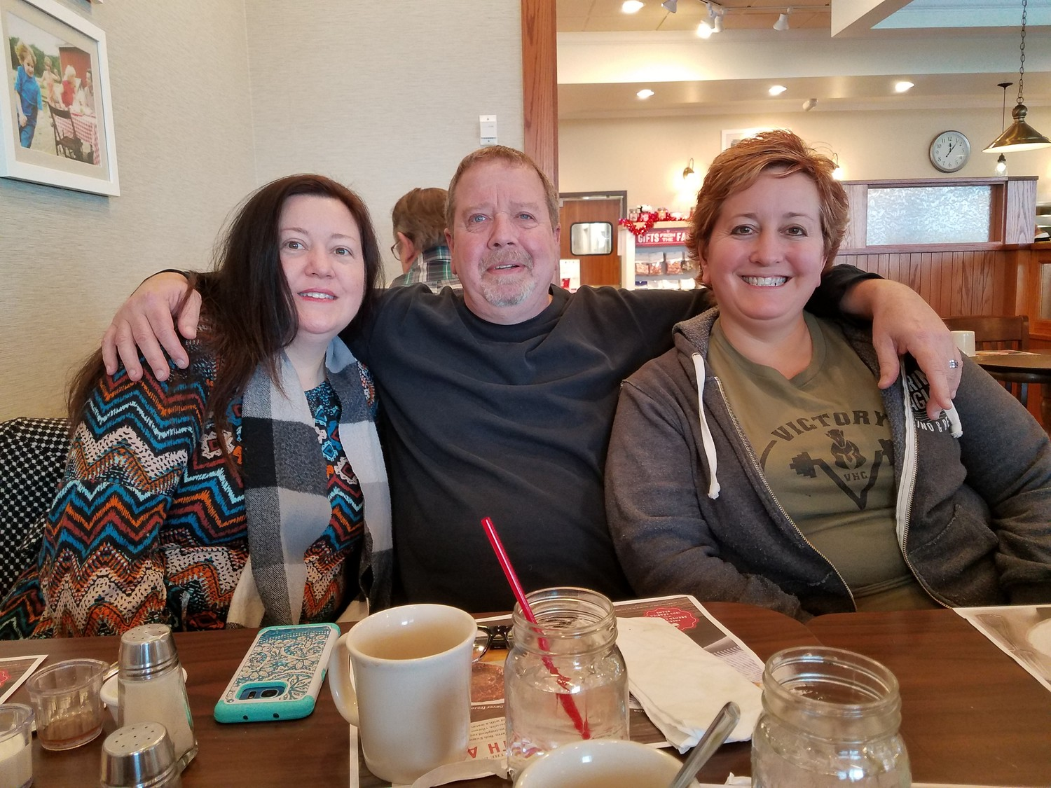 After decades of not knowing his biological family, Scheurer recently met his siblings for the first time — Jane Hunyor, left, and Charlann Haener.