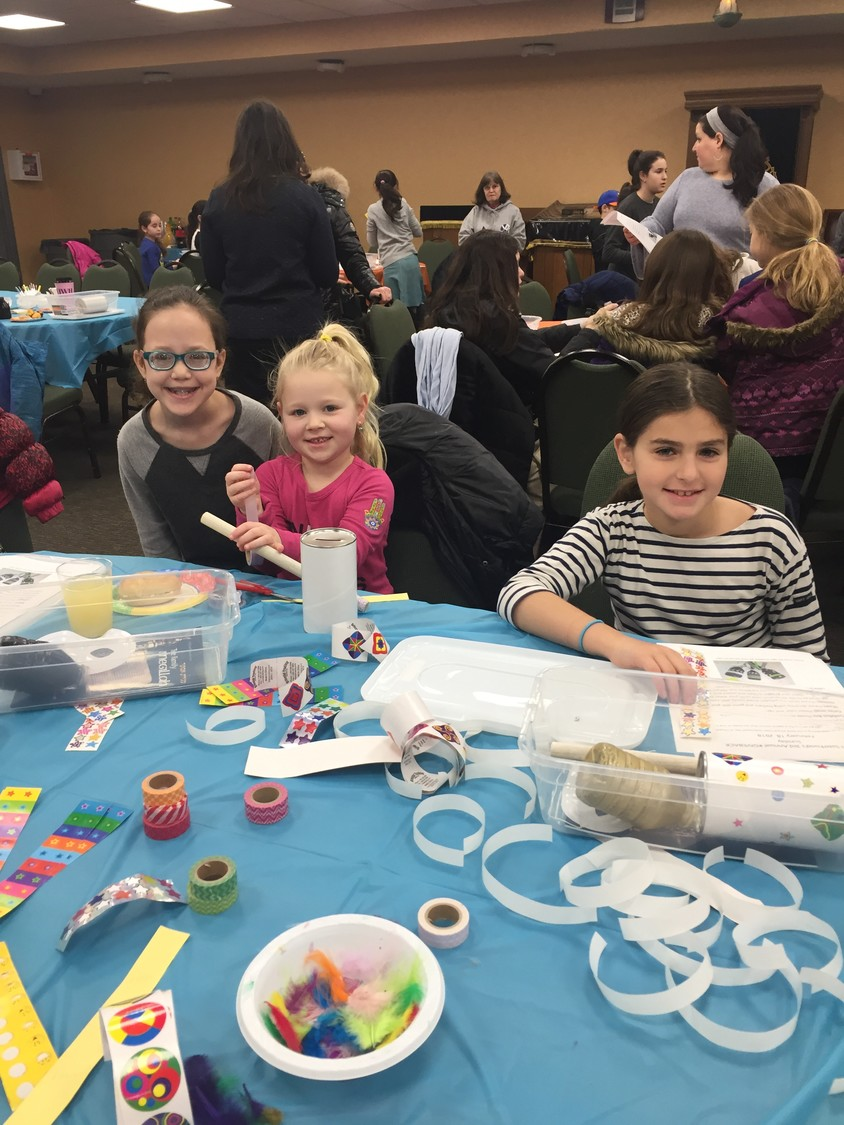 Children helped to decorate packages for patients at the North Shore University Hospital.