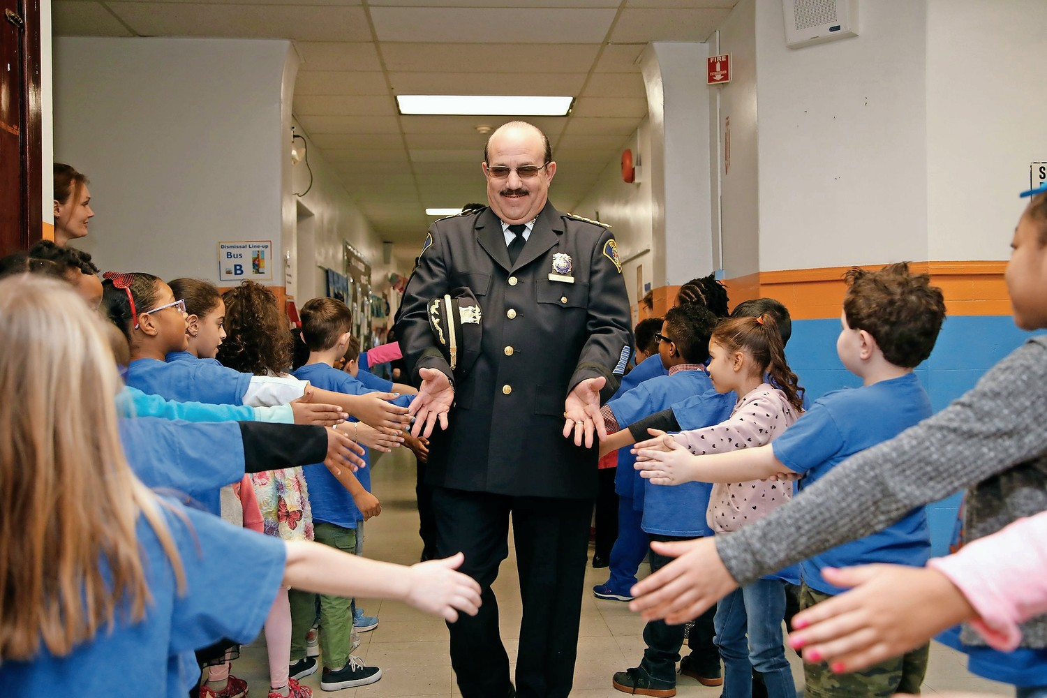 Malverne Police Reserves Chief Bob Oliva was welcomed at Downing School.