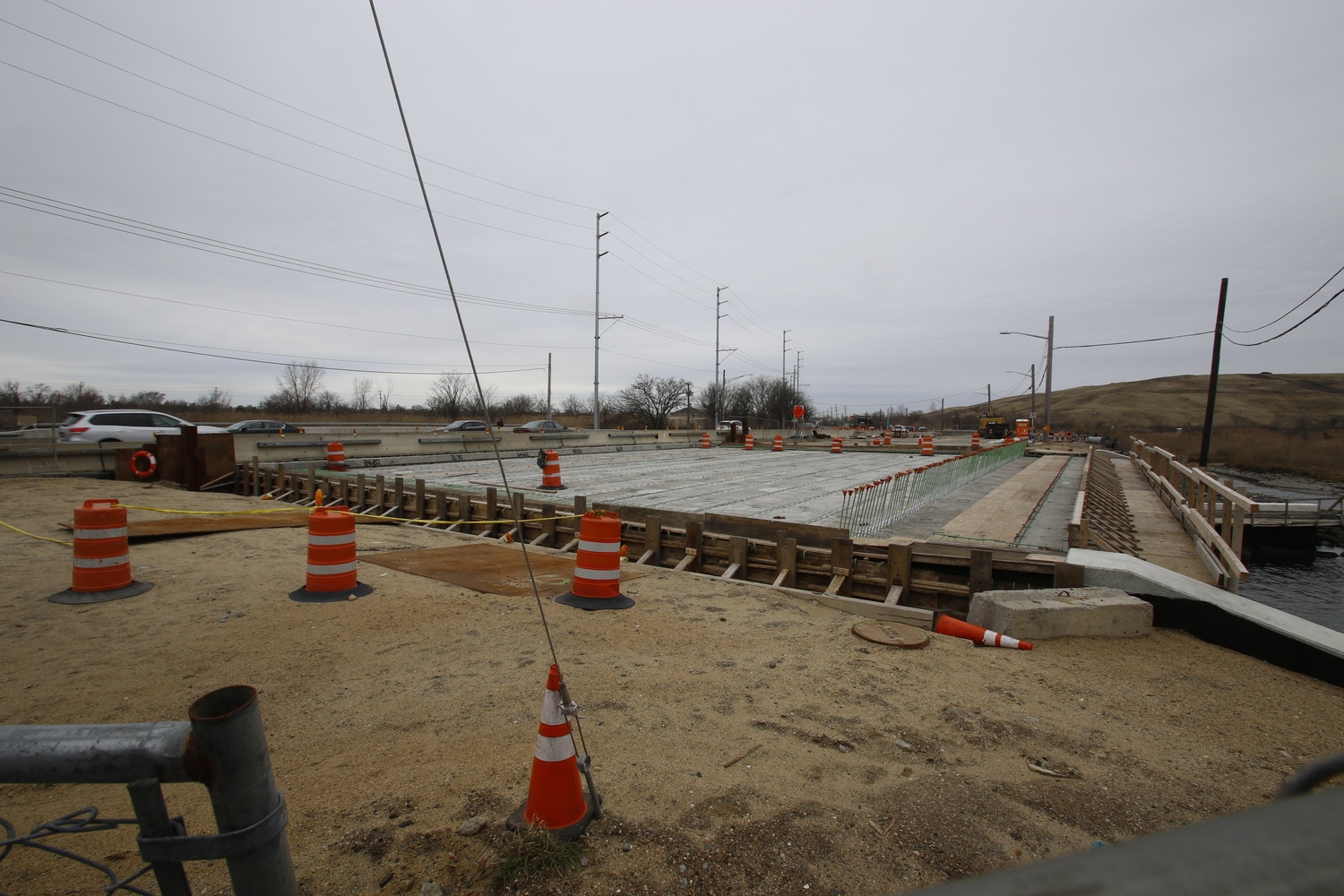 Construction on the Barnum Island Bridge was paused because the county missed its window to pour concrete on the northbound side of the span before the winter months. County officials gave a number of reasons for the delay.