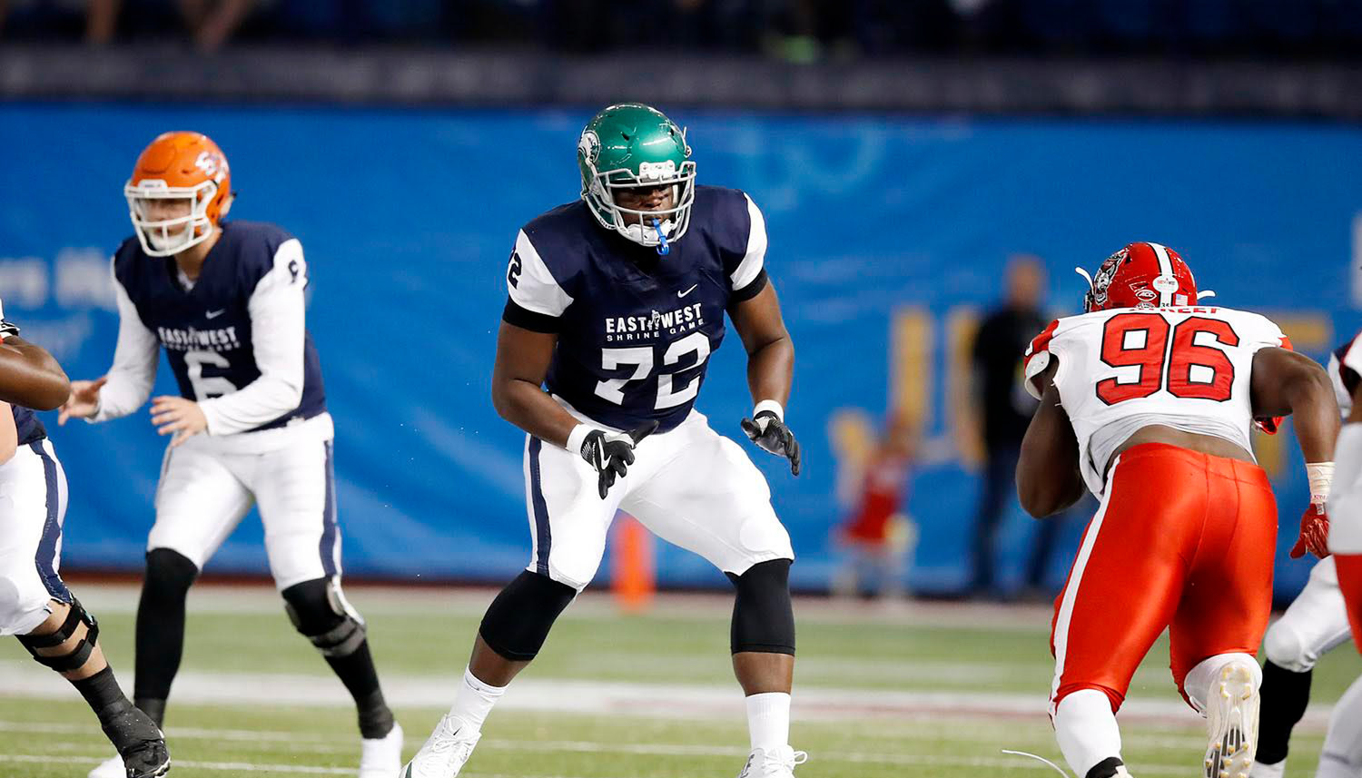 Elmont Native Greg Senat, at left above, playing for the West in the 93rd East-West Shrine All-Star Game on Jan. 20, was invited to the NFL Combine. He was a member of the Wagner University Seahawks' offensive line.