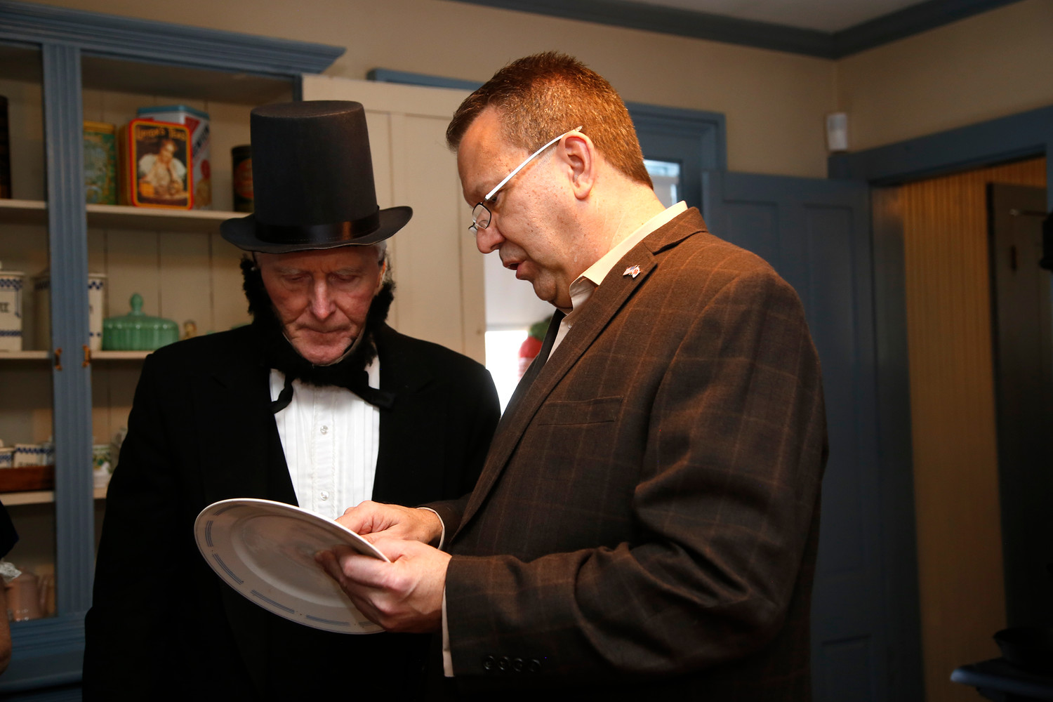 Mayor Ed Fare and Dave McKean examined a plate that was from George Washington's house in Mount Vernon.