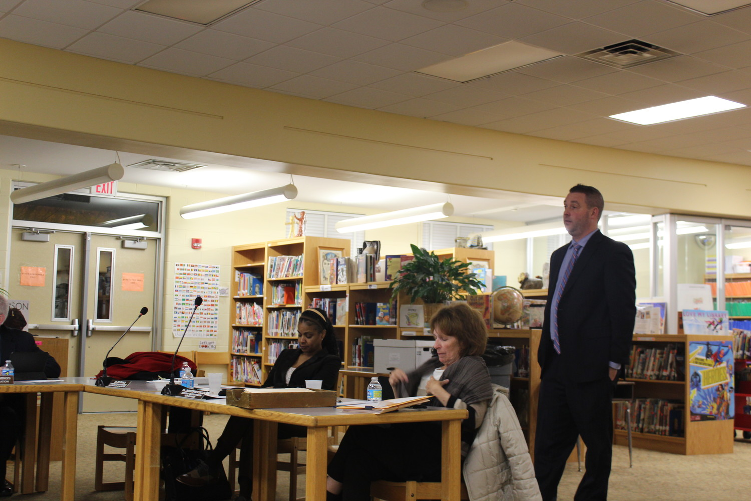 Chris Dillon (right) spoke to residents about the tax levy increase on Feb. 12.