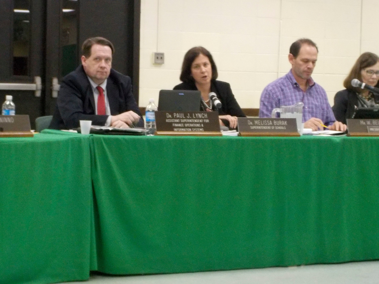 Paul Lynch, left, Lynbrook's assistant superintendent of finance, operations and information systems, presented the district's smart bond proposal in December 2016. Superintendent Dr. Melissa Burak, second from left, wrote a letter to the State Education Department last month after the school shooting in Parkland, Fla., because the nearly $893,000 plan — which focuses on school safety initiatives — has yet to be approved.