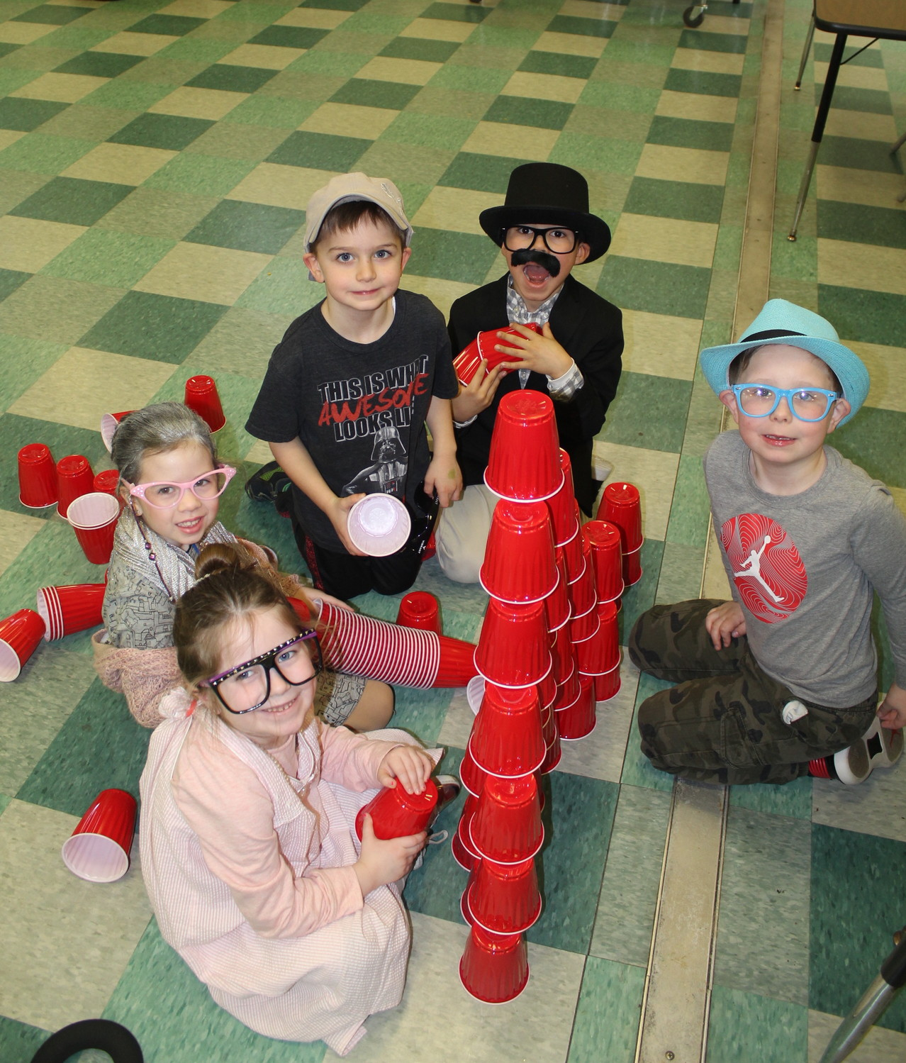 For one of Chatterton's 100th day stations, students were asked to count and construct a tower from 100 cups.