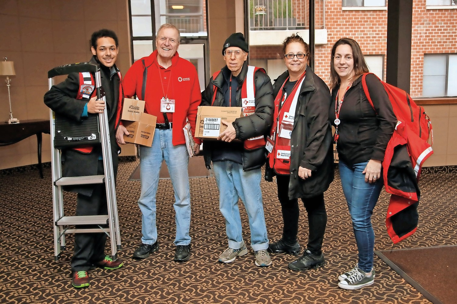Dominic Jenkins, left, Paul Nulty, Peter King, Karen Serani and Lori-Ann Pizzarelli, helped install smoke alarms on Feb. 24 as volunteers for the American Red Cross.
