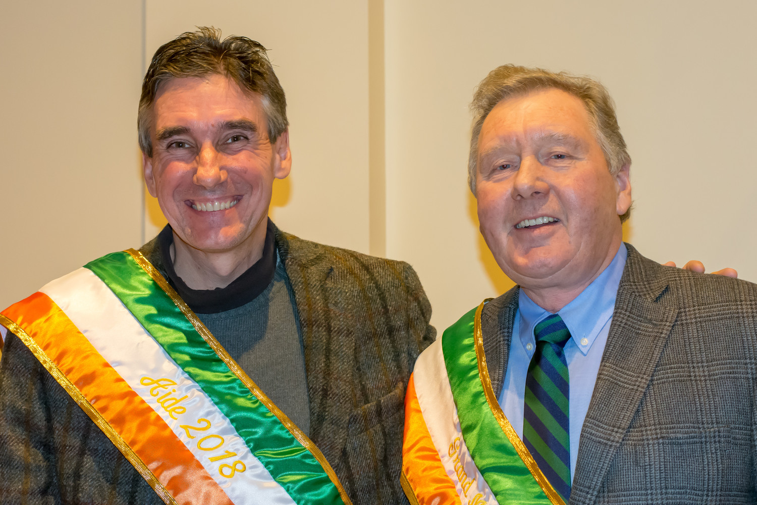St. Patrick's Parade Aide Kevin Horton, former editor of the Gold Coast Gazette, left, was happy to be presented with an honorary sash alongside Grand Marshal Bill Doherty on Feb. 17.