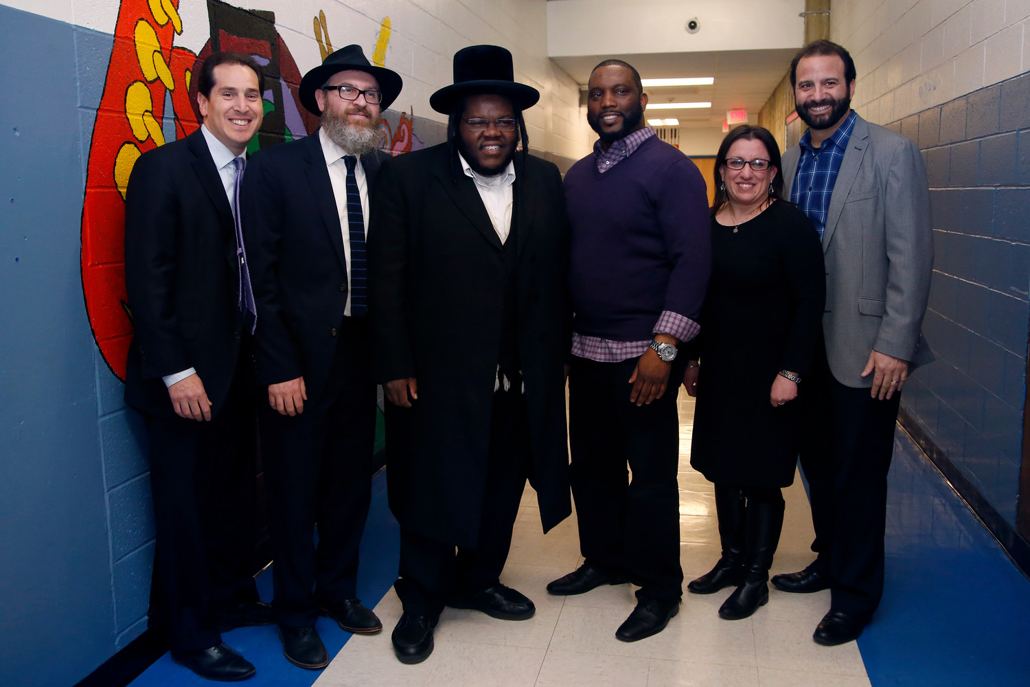 State Sen. Todd Kaminsky, left, with Rabbi Eli Goodman, rapper Nissim Black, Martin Luther King Center board chairman James Hodge, City Council Vice President Chumi Diamond and City Council President Anthony Eramo at the concert.