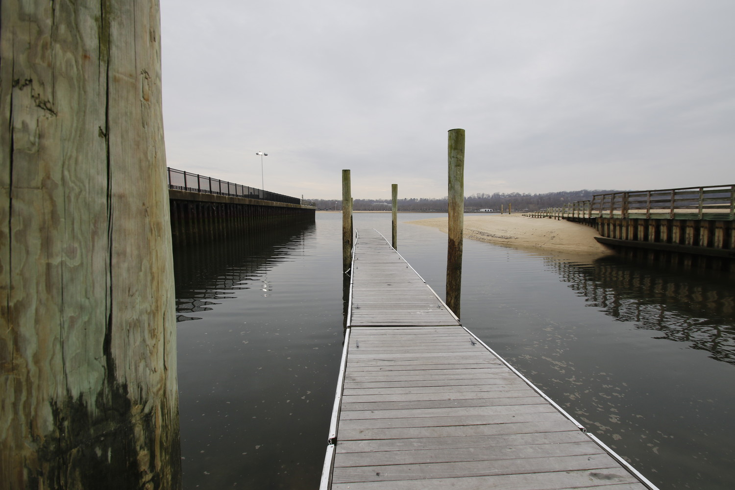 A dock wades out into Hempstead Harbor.