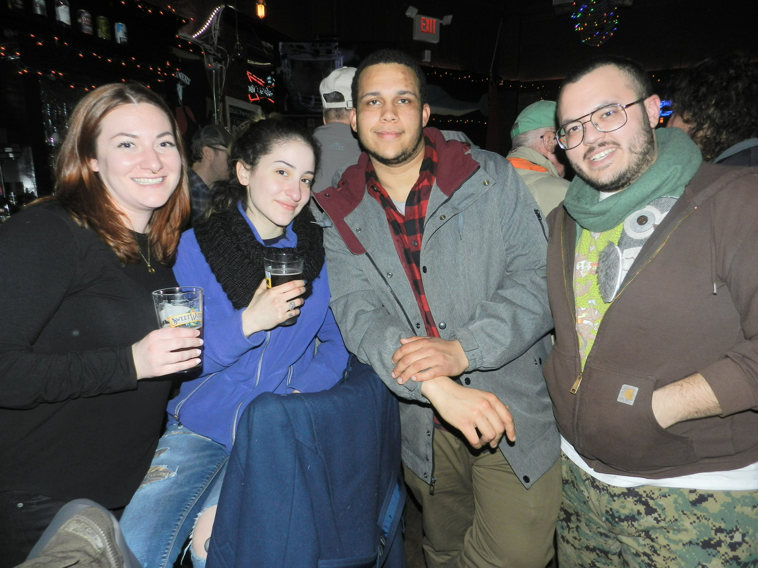 From left: Kayte Jolly, Jahira Flores, Gunner Andahazy and Will Ehmann enjoyed catching up at the bar during the crawl.