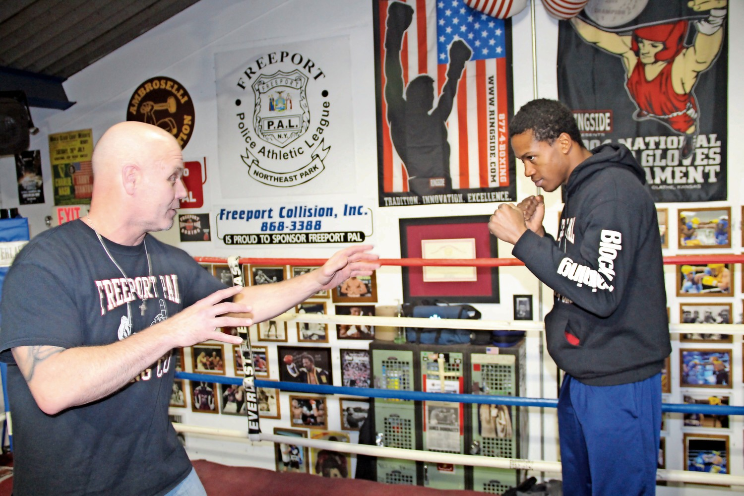 Joe Higgins, left, a Freeport Athletic League boxing coach, and boxer Patrick Day sparred playfully in the ring on Tuesday.
