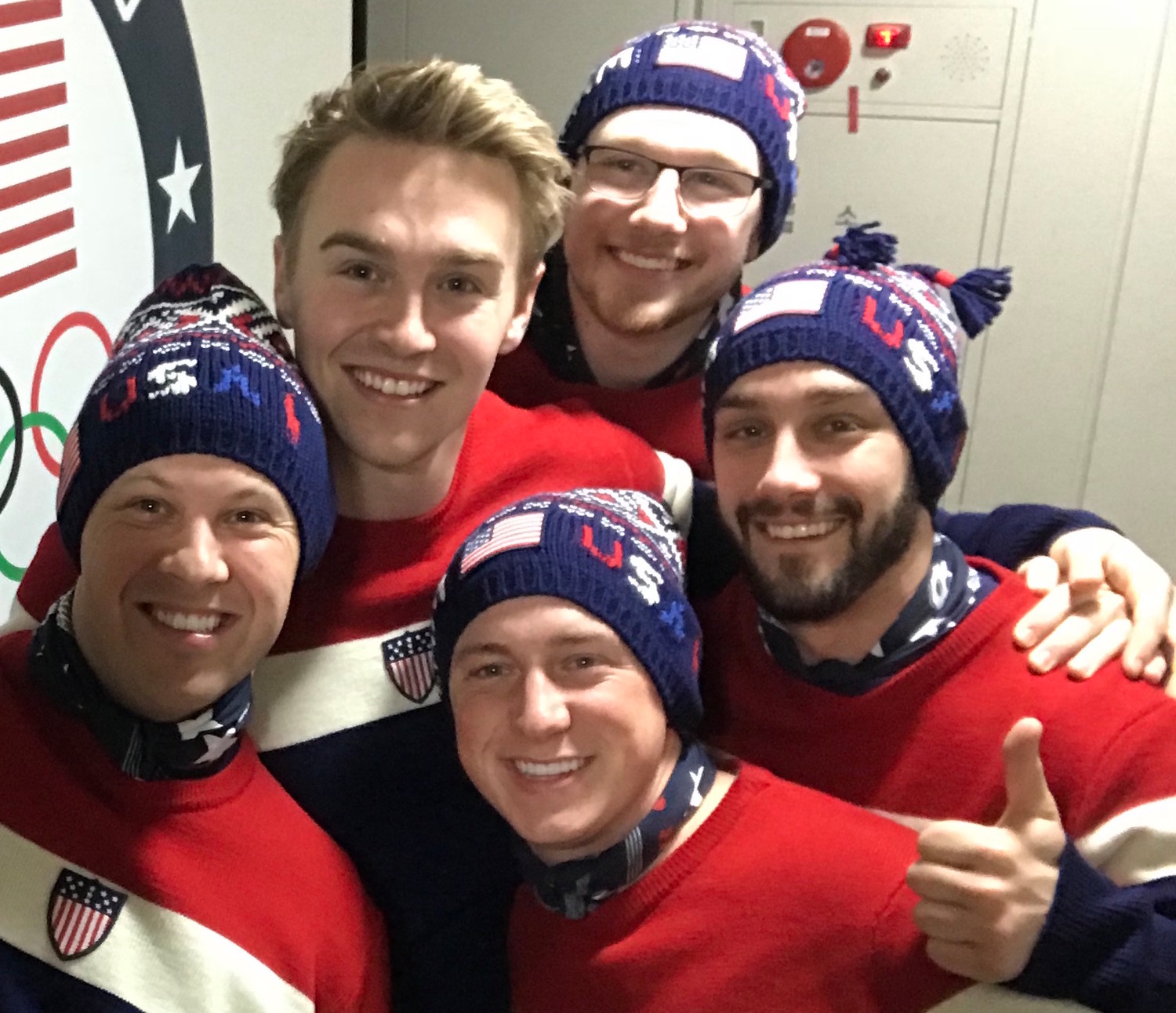 Mat Mortensen, bottom left, a St. Dom alum, took a selfie with some of his teammates at the Winter Olympics.