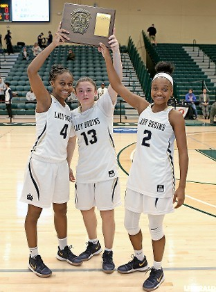 Baldwin captains, from left, Kaia Harrison, Jenna Annecchiarico and Aziah Hudson led the way to a 60-24 win over Massapequa last Saturday as the Lady Bruins claimed a fifth straight Nassau Class AA championship.
